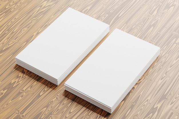 Business cards mockup. an image of two stacks of blank business cards on a wooden background. template for identity card. view from above. 3d rendering.