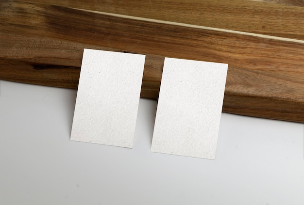 Business cards with wooden surface