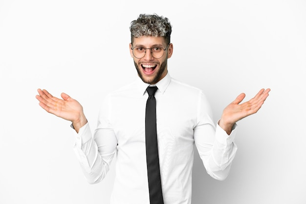 Business caucasian man isolated on white background with shocked facial expression