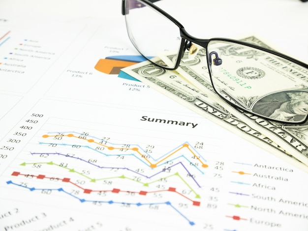 Business chart near dollars by unfocused glasses, financial concept
