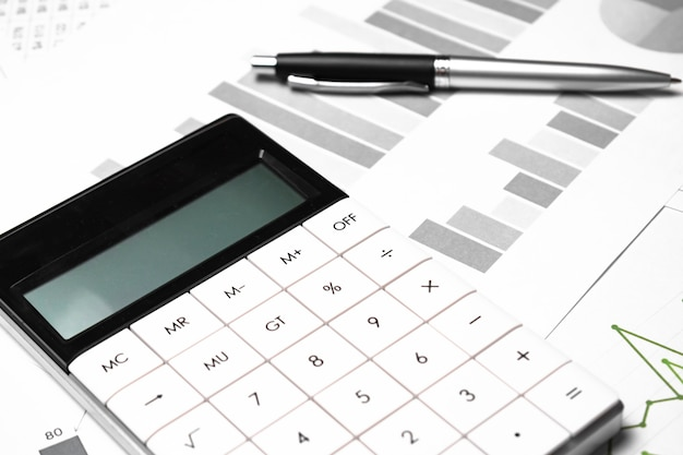 Business chart, pen and calculator