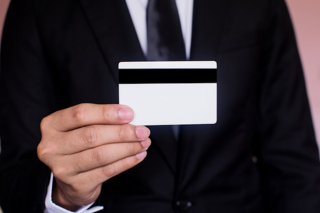 Business checking the transfer payment holding a credit card