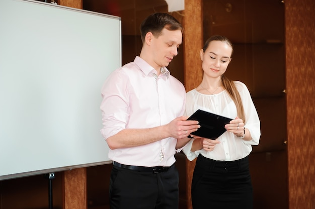 Business coach holding training for staff in the office.
