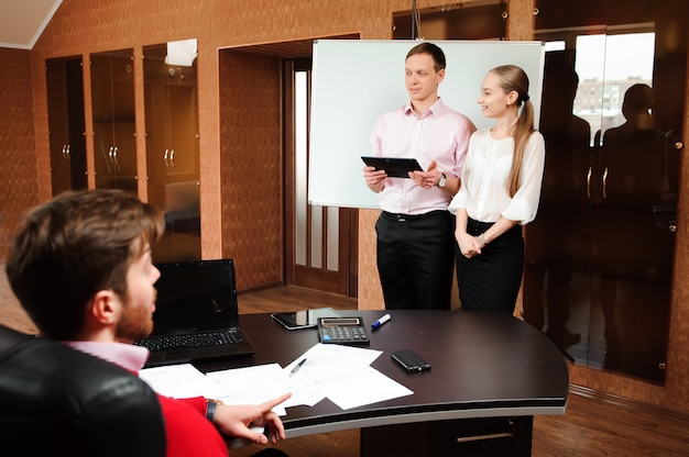 Business coach holding training for staff in office.