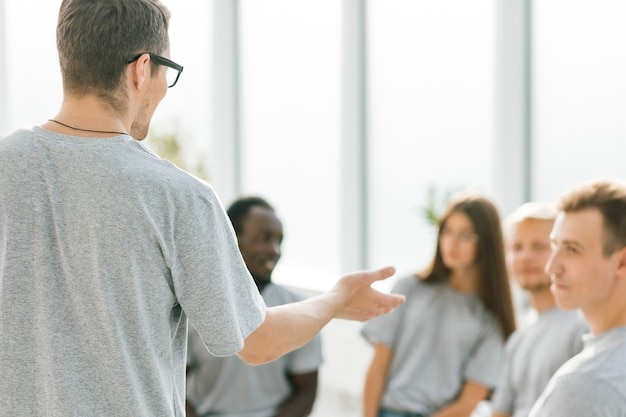Business coach holds a debate with a group of young people