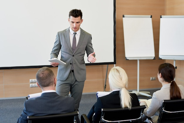 Business coach in training seminar