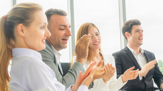 Business colleagues people woman applause and sitting and listening conference in meeting room.