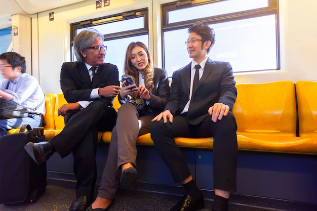 Business company meeting on skytrain transit system public impassioned while going work in