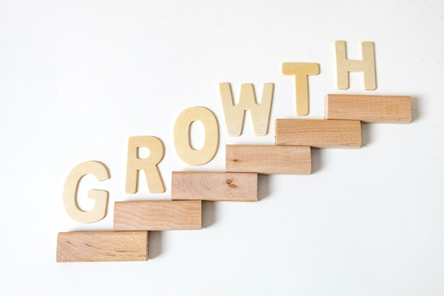 Business concept for growth success process. stairs up as a symbol of career growth up or business success. the word written that growth.
