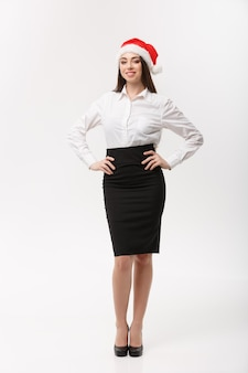 Business concept  modern caucasian business woman in christmas theme posing on white  wall with copy space
