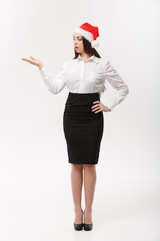 Business concept  modern caucasian business woman in the white  wall holding hand onside presenting product