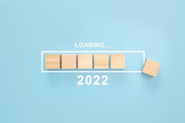 Business concept of planning 2022 loading new year 2022 cube in progress bar new year start concept