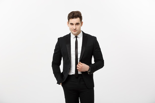 ビジネスコンセプト:灰色の背景に分離されたハンサムなビジネスマンの肖像画。