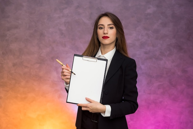Business concept. stylish businesswoman in elegant suit posing on abstract background