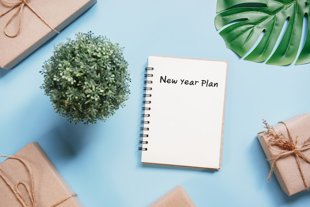 Business concept. top view blank white notebook writing new year plan