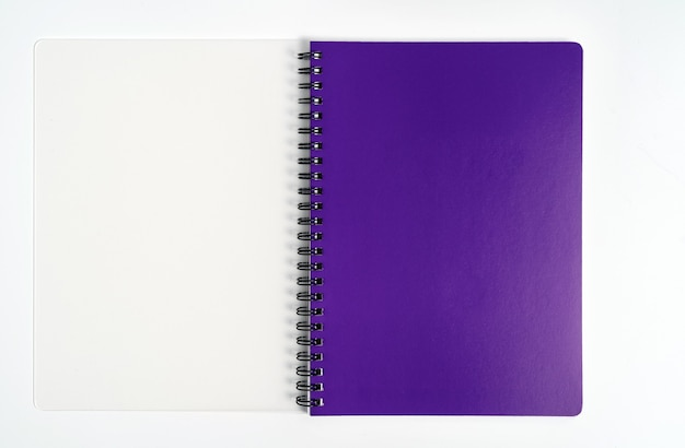 Business concept - top view collection of spiral kraft notebook front, purple and white open page isolated on background for mockup