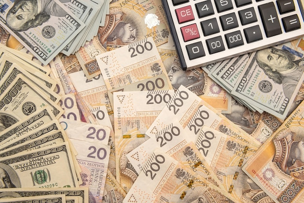 Business concept with calculator and pln polish banknotes 200. exchange or accounting