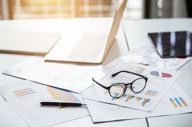 Business concept with image with graph on notebook and pen