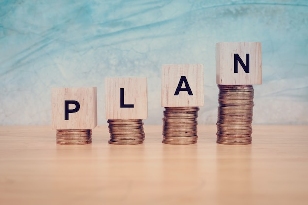 Business concept. wooden blocks with text plan on table. copy space