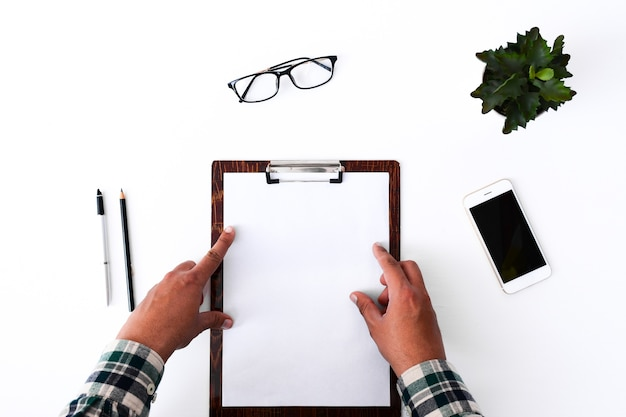 Business concept,working with clipboard pen on table background