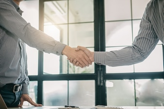Business confident handshake and business people after discussing , success  concept