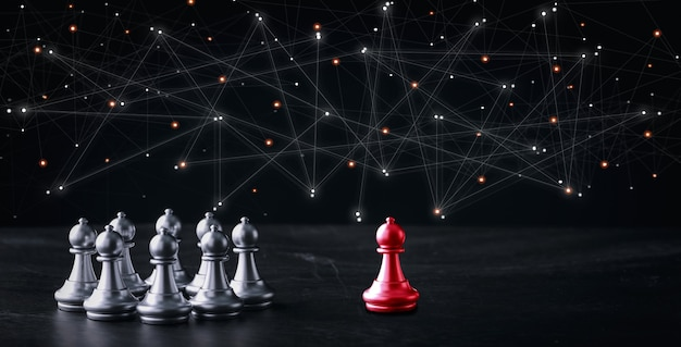 テーブルの上の未来的なグラフィックアイコンとビジネス戦略と戦術のビジネスコントロールチェスボードゲーム。広告コンテンツの管理競争、成功、リーダーシップの概念のアイデア。