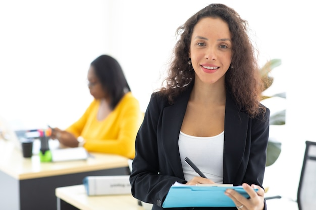 Business corporate leadership concept. beautiful young happy smiling professional hispanic black woman in modern home office