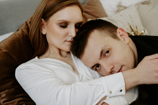 Business couple on bed in hotel room