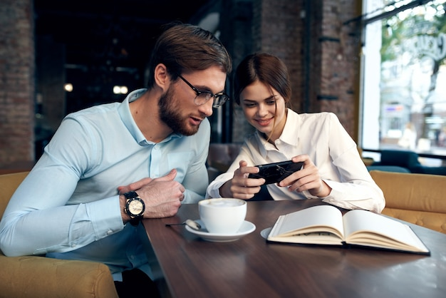Business couple sitting at a table in a cafe breakfast communication work