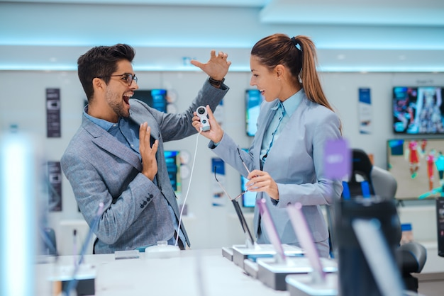 Business couple at tech store shopping