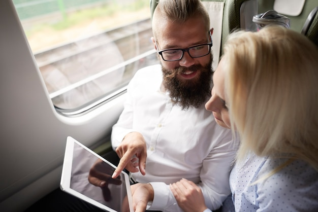 Business couple with digital tablet