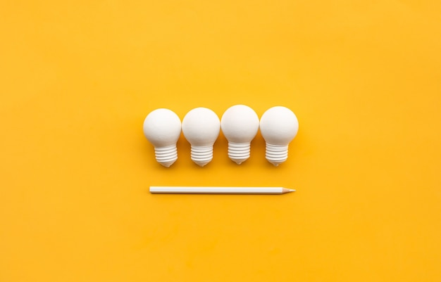 Business creativity and inspiration concepts with lightbulb and pencil