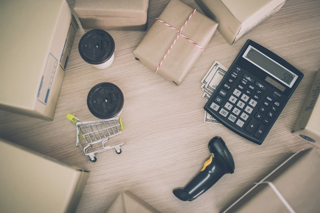 Business delivery logistic ideas concept with package calculator and paper document on working desk