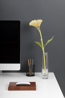 Business desk concept with flower