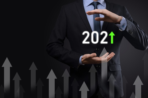 Business development to success and growing growth year 2021 concept.plan business growth graph in year 2021 concept.businessman plan and increase of positive indicators in his business