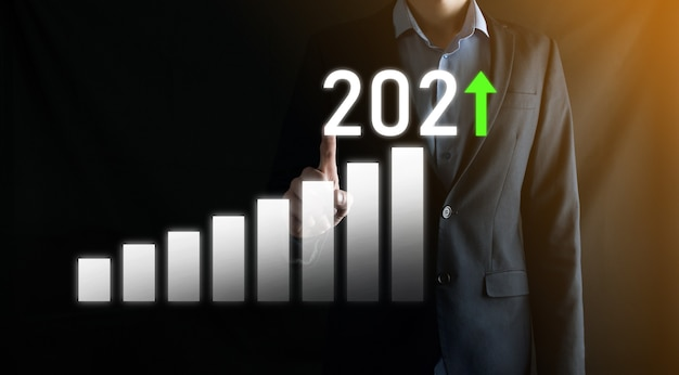 Business development to success and growing growth year 2021 concept.plan business growth graph in year 2021 concept.businessman plan and increase of positive indicators in his business.