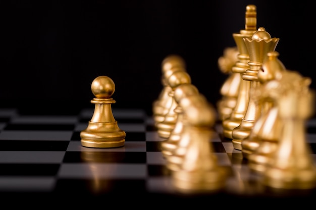 Business and employee concept, chessmen leader move and play fist
