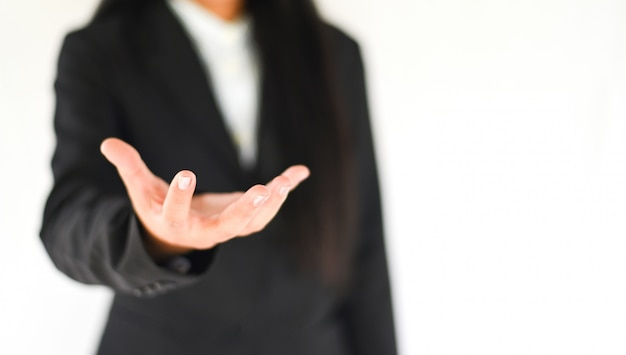 Business empty hand workpiece gesture show stretches out. business woman in suit shows use hand to hold something.