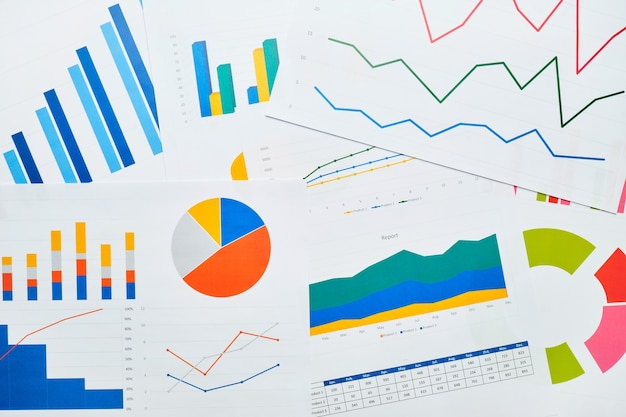 Business endpoint with reporting charts on paper