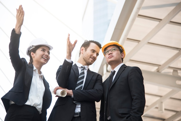 Business engineer hand holding construction drawing.
