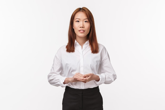 Business, entrepreneur and career concept. professional asian young woman boss running own company, standing in white shirt and skirt, , introduce project to team