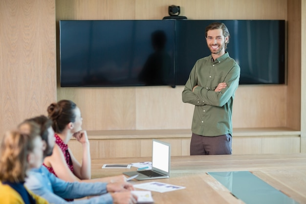 Business executive giving presentation to colleagues