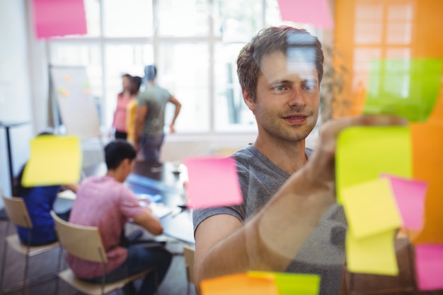 Business executive reading sticky notes