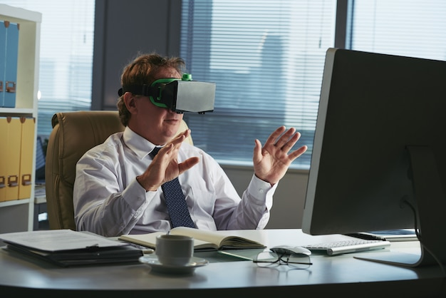 Business executive in vr headset in his office