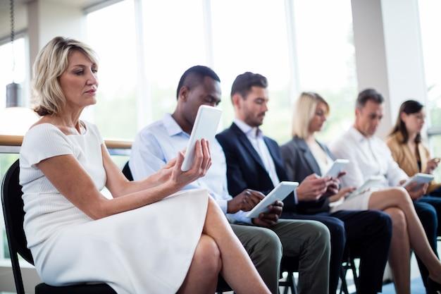 Business executives using digital tablet