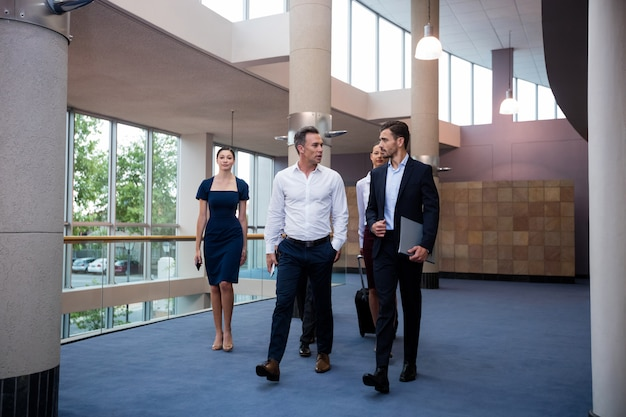 Business executives walking in a conference center lobby