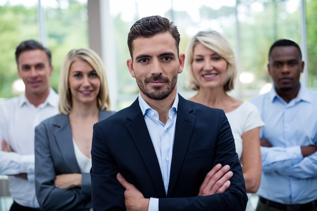 Business executives with arms crossed at conference center