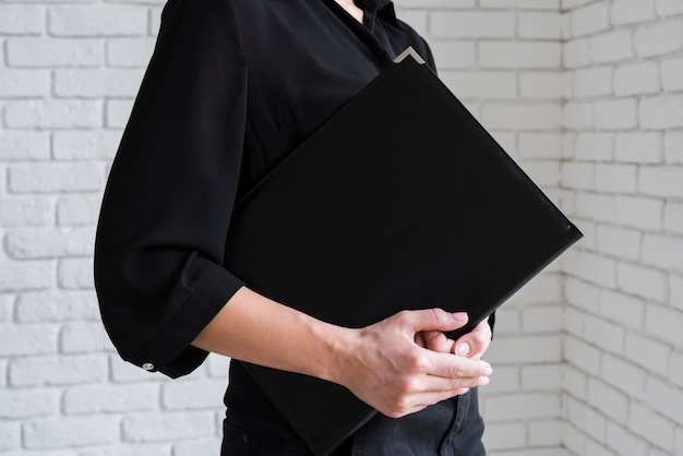 Business female holding clipboard