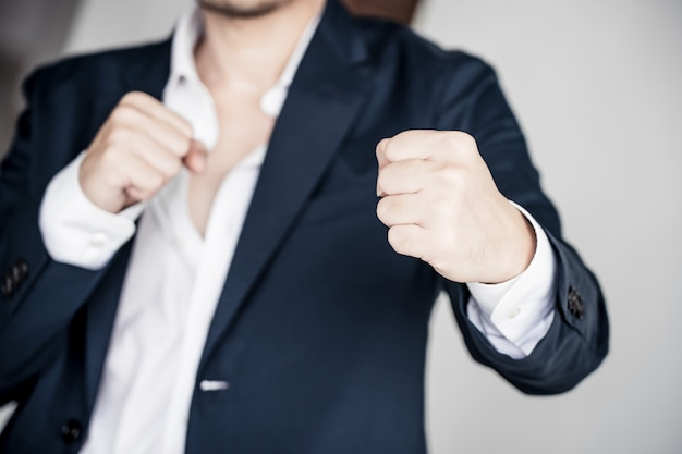 Business fighting to success concept. businessman with fighting pose.