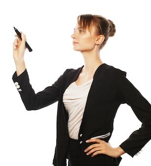 ビジネス、金融、人々の概念:マーカーで空中で何かを書く若いビジネス女性